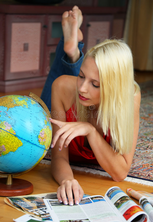 Plan a journey. A woman is planning a journey stock photography