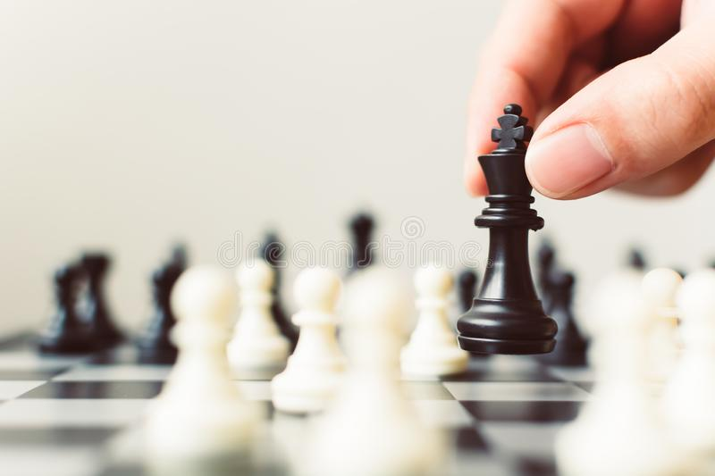Plan leading strategy of successful business competition leader. Concept, Hand of player chess board game putting black pawn, Copy space for your text stock image