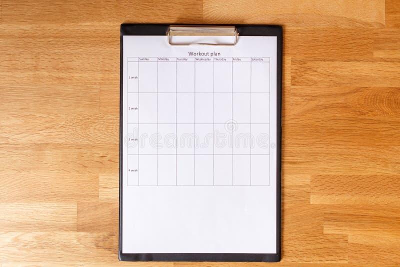 Plan personnel de séance d'entraînement sur le fond en bois photographie stock
