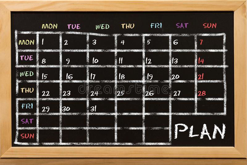 Plan pour la semaine pendant le tableau noir images libres de droits