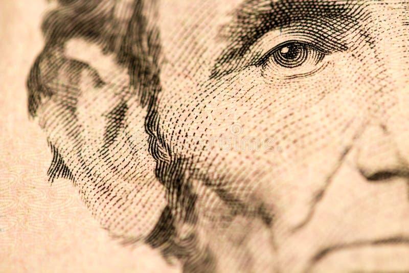 Plan rapproché d'Abraham Lincoln Face sur billet de cinq dollars photographie stock libre de droits
