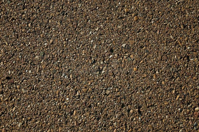 Plan rapproch? d'asphalte avec le gravier ins?r? dans lui photos stock