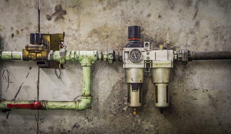 Plan rapproché d'un mètre de pression sur une machine photo stock