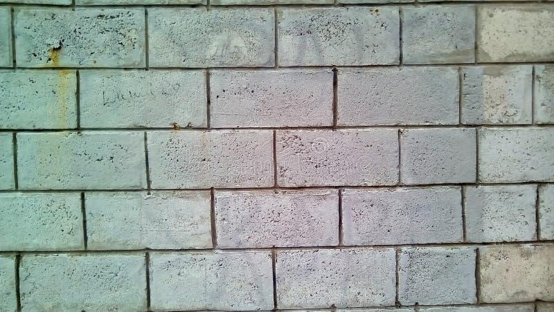 Plan rapproché d'un morceau de mur de briques blanc photos libres de droits
