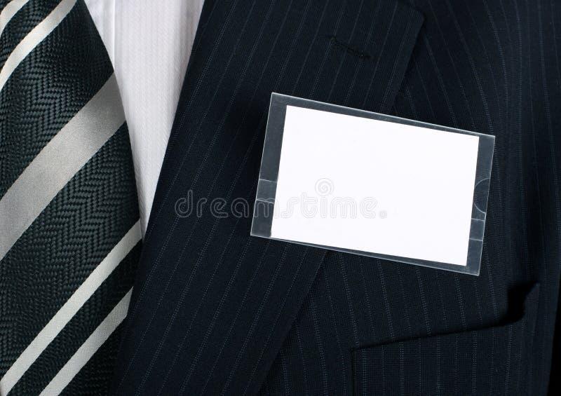 Plan rapproché d'un nametag blanc photo stock
