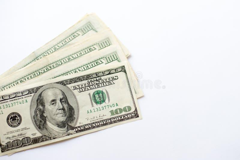 Plan rapproché de billets de banque de dollar US de devise sur le fond blanc photo stock