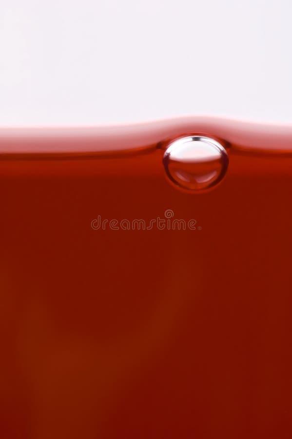 Plan rapproché de bulle d'air en vin rouge. photographie stock libre de droits