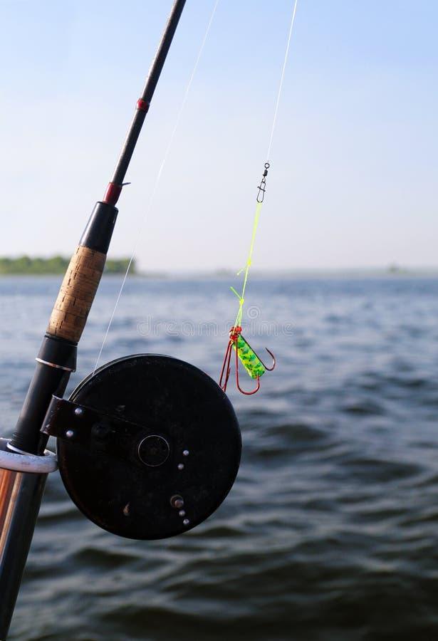 Plan rapproché de canne à pêche de mouche photographie stock libre de droits