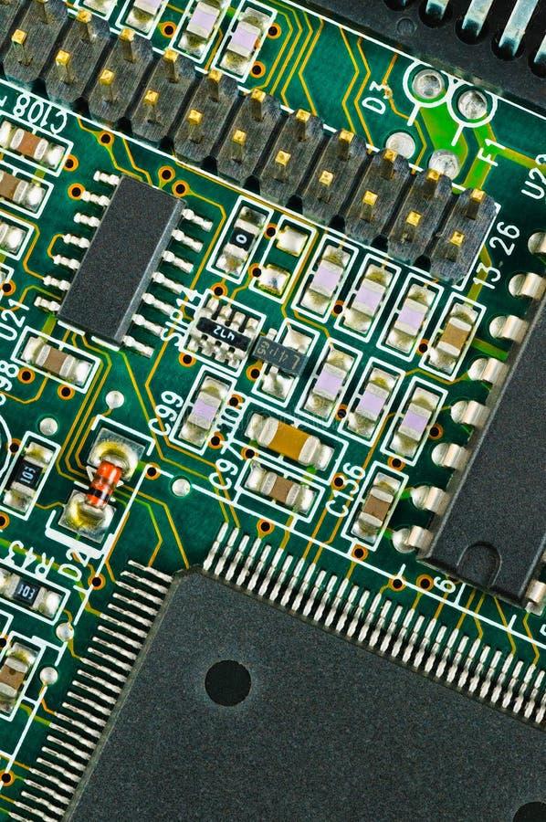 Plan rapproché de carte électronique verte de carte photographie stock