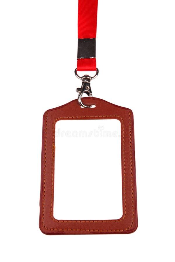 Plan rapproché de carte vierge d'identification d'insigne avec la lanière rouge image stock