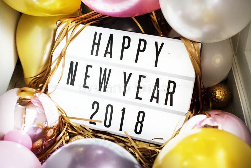 Plan rapproché de conseil de la bonne année 2018 en partie image stock