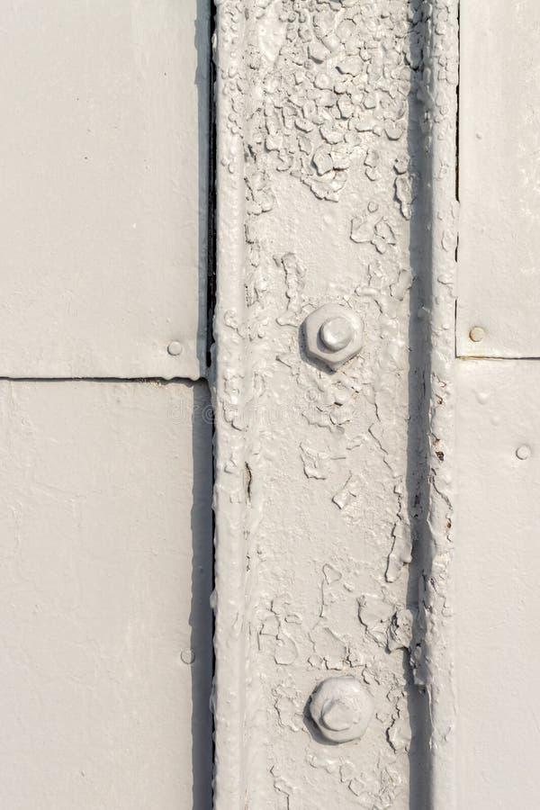 Plan rapproché de Grey Painted Bolt et de métal photo stock