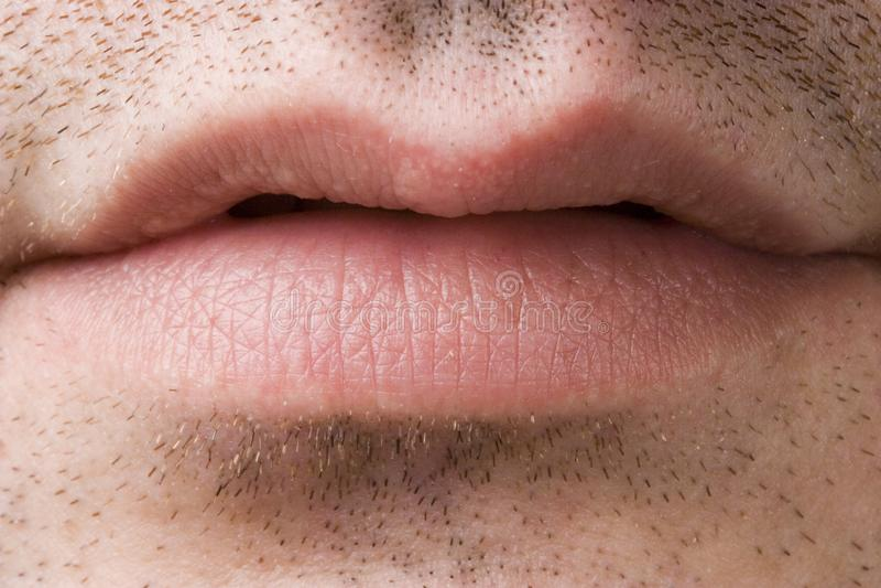 Plan rapproché de la bouche d'un homme photos stock