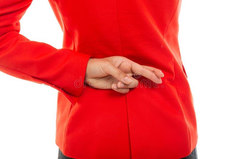 Plan rapproché de la vue arrière de la femme d'affaires montrant des doigts croisés photographie stock