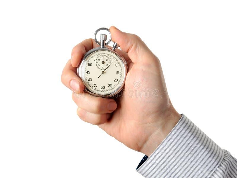 Plan rapproché de main tenant le chronomètre, d'isolement sur le fond blanc images libres de droits