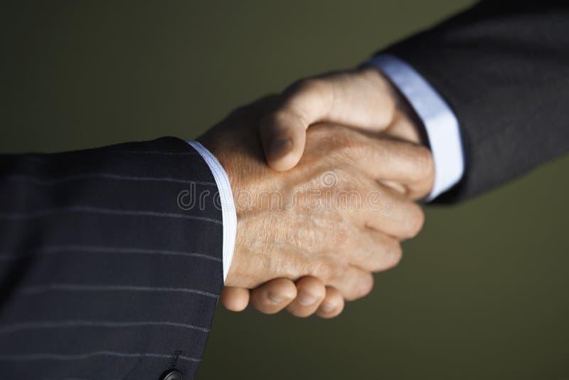 Plan rapproché de poignée de main photo libre de droits