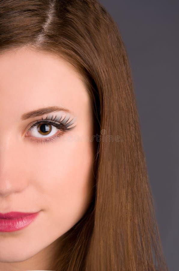 Plan rapproché de renivellement d'art sur le modèle de visage photo stock