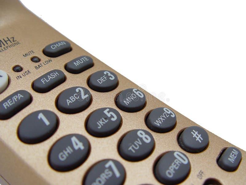 Plan rapproché de téléphone d'or images stock