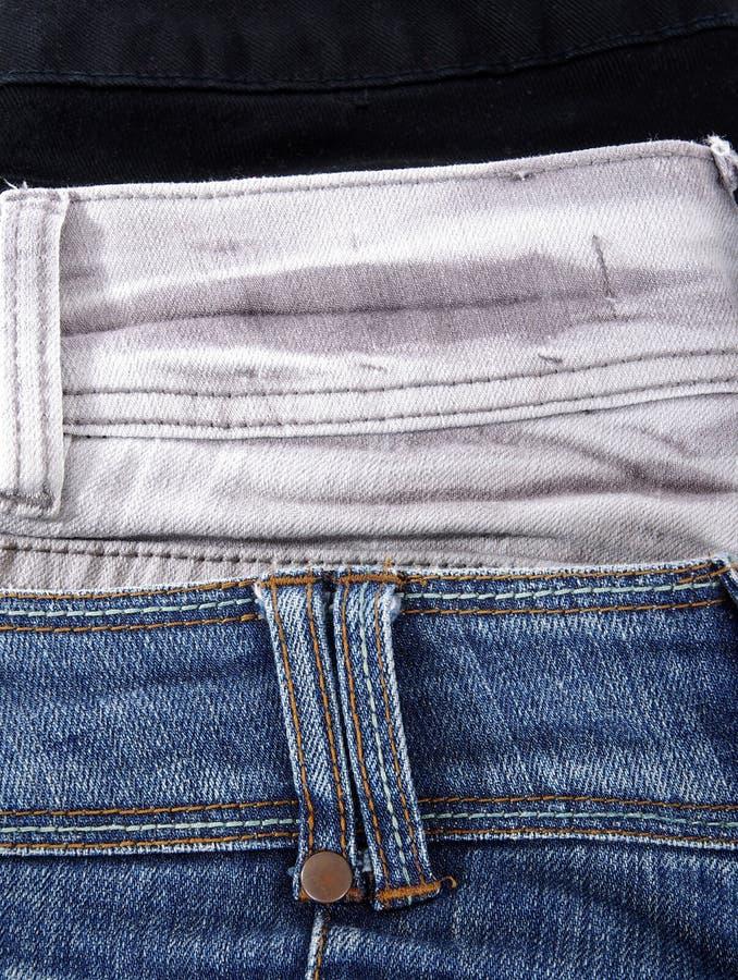 Plan rapproché de trois jeans photographie stock libre de droits
