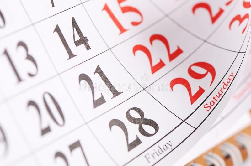 Plan rapproché des dates à la page de calendrier photo stock