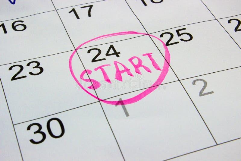 Plan rapproché des dates à la page de calendrier, photo photo stock