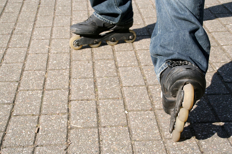 Plan rapproché des patins intégrés image libre de droits