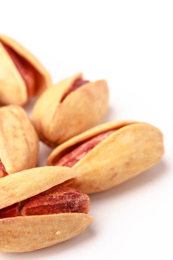Plan rapproché des pistaches salées photos stock
