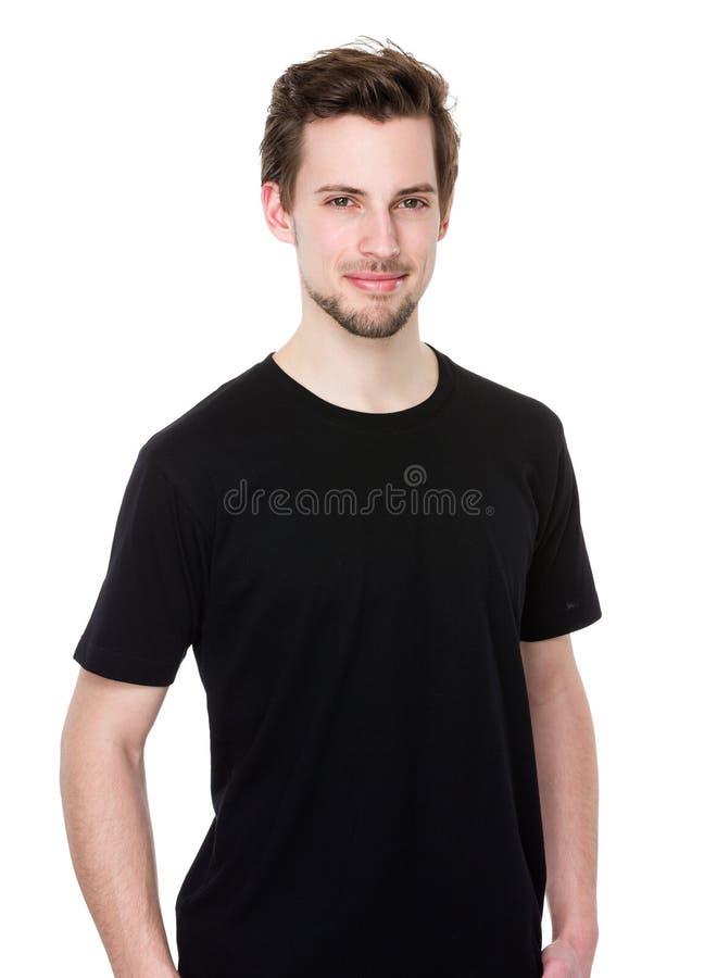 Plan rapproché du type de sourire heureux regardant l'appareil-photo d'isolement sur le blanc images stock