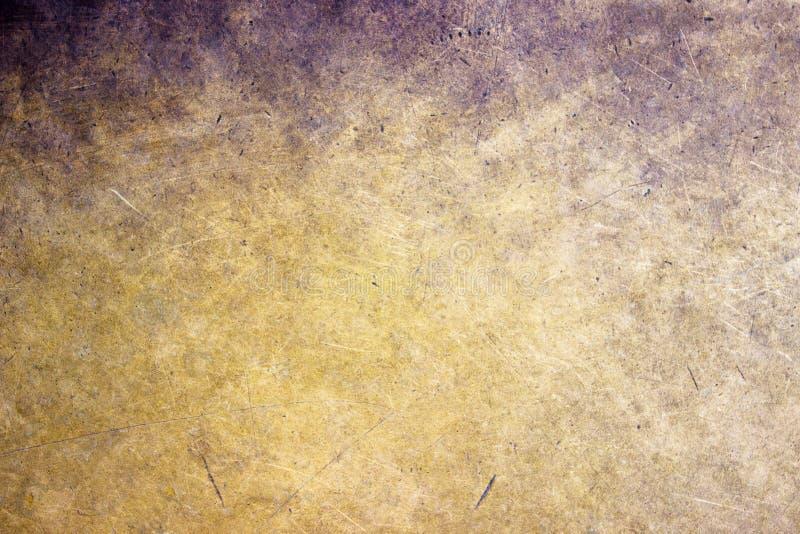Plan rapproché en bronze de fond en métal, texture mate avec une tonalité d'or photographie stock libre de droits