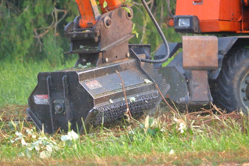 Plan rapproché industriel de coupeur de végétation photos stock