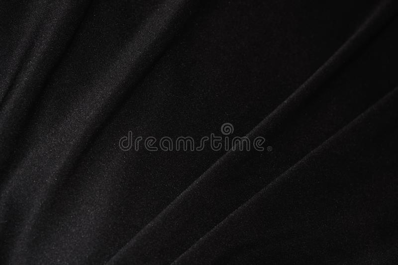 Plan rapproché noir mou de tissu de satin photos stock