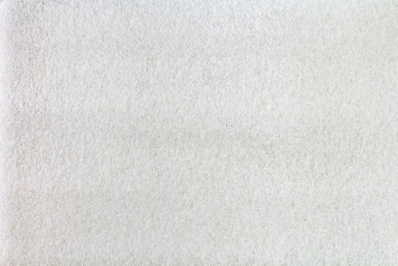 Plan rapproché pétillant blanc de film de mousse, fond de texture photographie stock