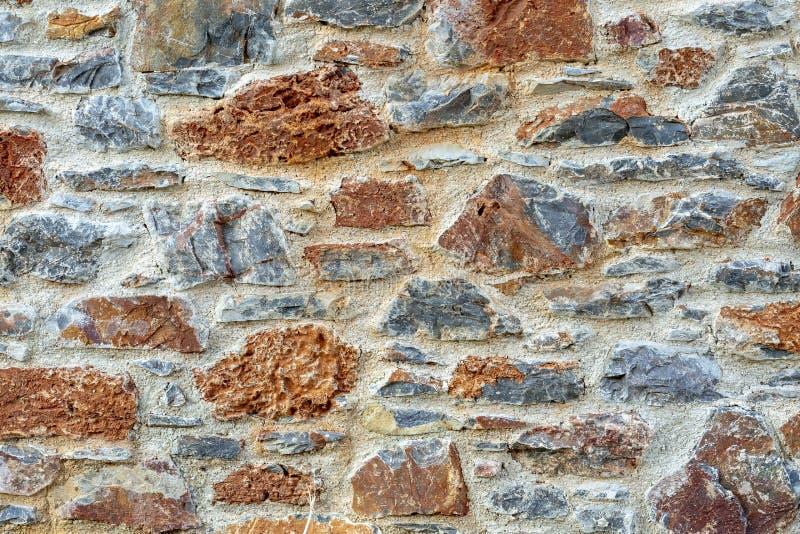 Plan rapproché rustique de fond de texture de barrière de mur en pierre photos stock