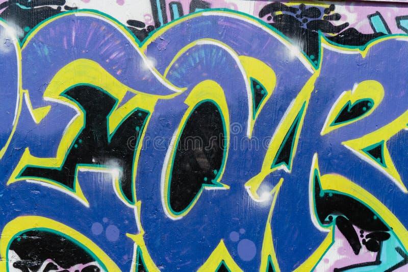 Plan rapproch? color? de style de graffiti de bel art abstrait de rue D?tail d'un mur Peut ?tre utile pour des milieux Iconique m photographie stock