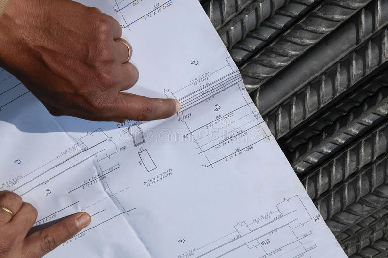 Plan and steel rebar. Detail of steel rebar with plan of construction stock image