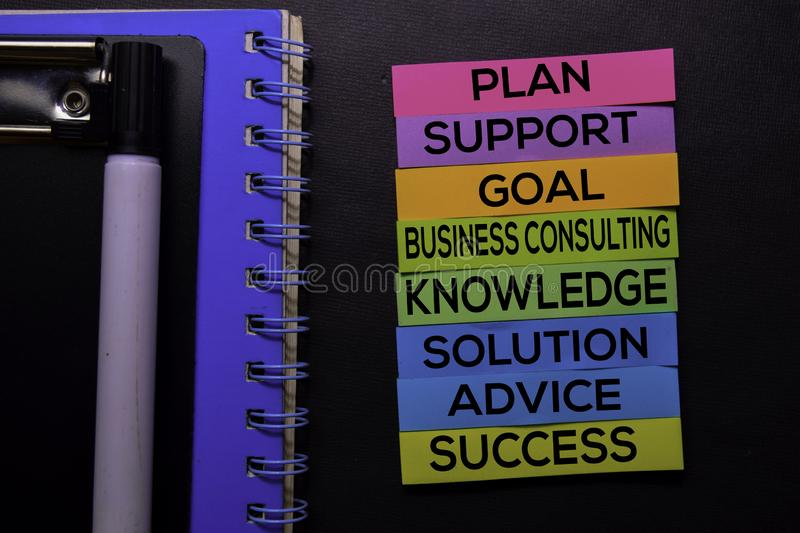 Plan, Support, Goal, Business Consulting, Knowledge, Solution, Advice, Success text on sticky notes isolated on Black desk. royalty free stock photos
