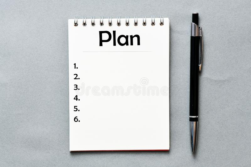 Plan text in notebook on gray background. View from above. High resolution photography - business concept. royalty free stock image