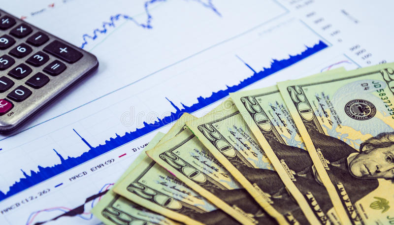 Plan to invest on stock market. Money and calcaulator on stock chart royalty free stock photography