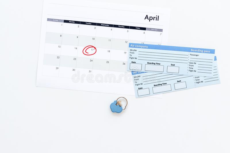 Plan a trip. Buy airplane tickets. Tickets near calendar with date circled on white background top view copy space. Plan a trip. Buy airplane tickets. Tickets stock image