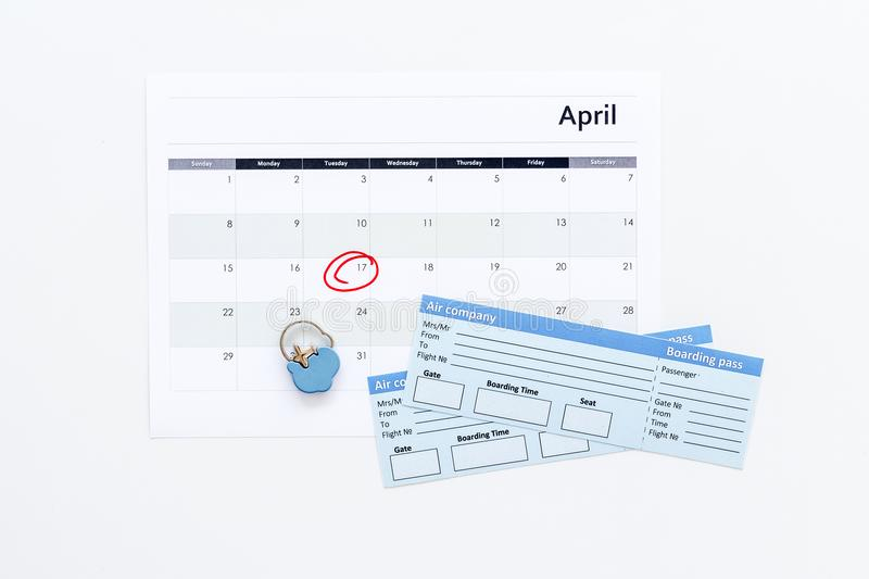 Plan a trip. Buy airplane tickets. Tickets near calendar with date circled on white background top view copy space. Plan a trip. Buy airplane tickets. Tickets royalty free stock photography