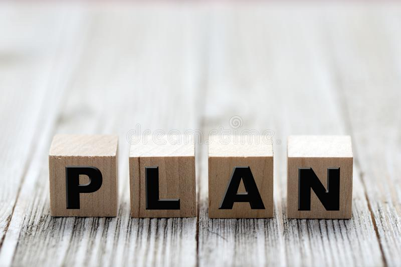 Plan word on wooden cubes stock photography