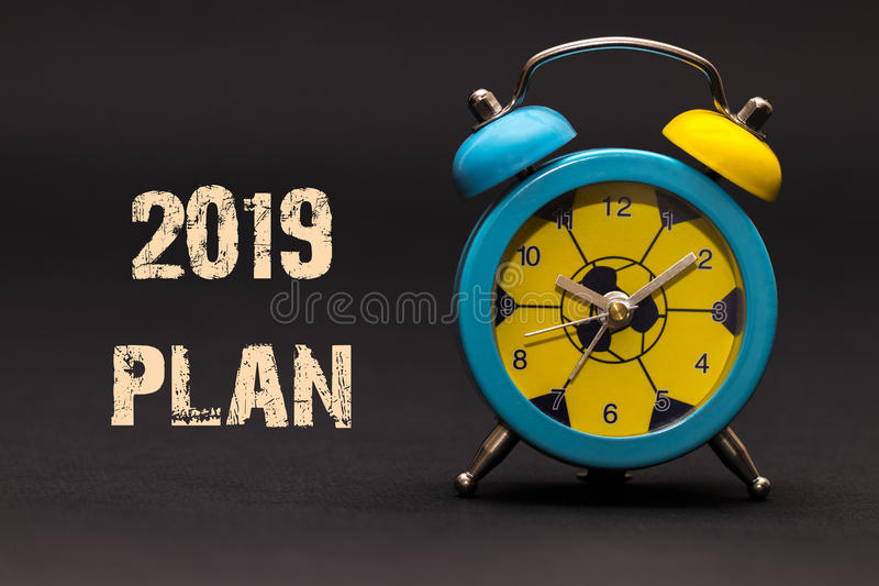 2019 plan written with alarm clock on black paper background royalty free stock images