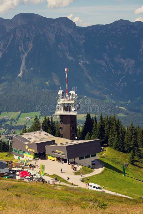 Planai telecommunication tower with flying paragliders in background. Schladming, Austria stock images