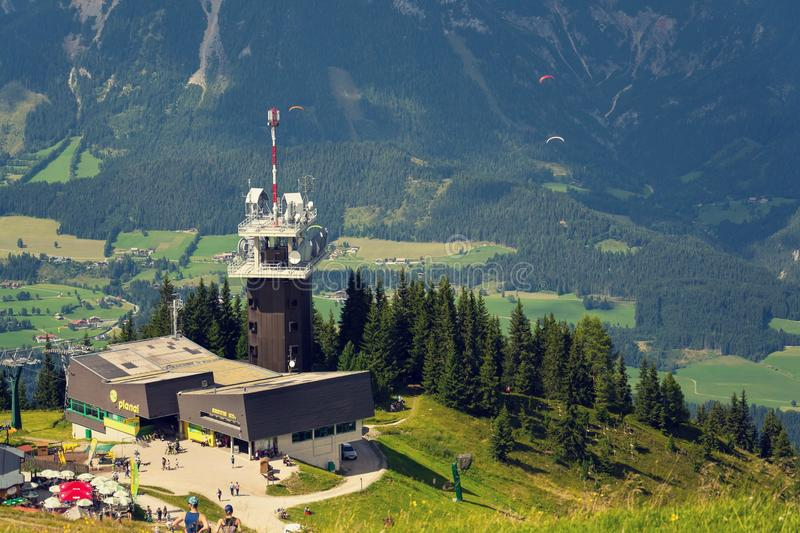 Planai telecommunication tower with flying paragliders in background. Schladming, Austria stock photos