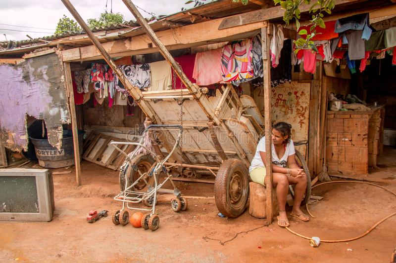 Planaltina, Goias, Brazil-December 8, 2018: A poor girl sitting out in front of her home. Planaltina, Go¡as, Brazil-December 8, 2018: A poor girl sitting out stock images