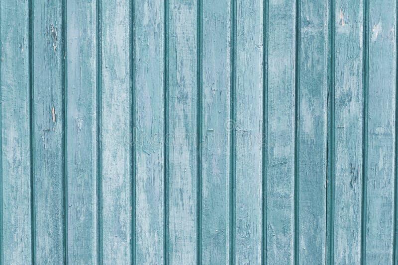 Plance di legno strette Bordi verticali di legno grigi e blu-chiaro Vecchio recinto colorato Weathered Struttura approssimativa B immagini stock libere da diritti
