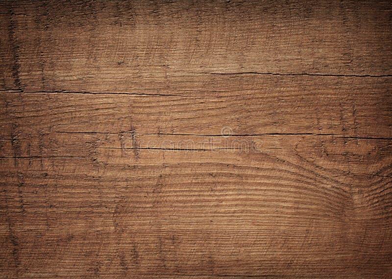 Planche à découper en bois rayée de brun foncé Bois photos stock