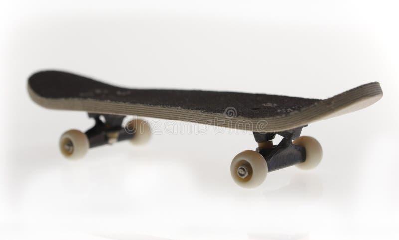 Planche à roulettes d'isolement photographie stock