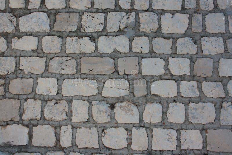 Plancher d'une rue avec les tuiles en pierre Plancher d'une rue avec les tuiles en pierre Archivio Fotografico - 78112153 image stock