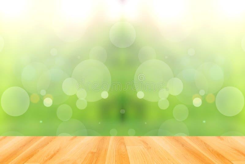 Plancher en bois et fond vert abstrait de bokeh photo stock